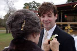 Mom helps me with my boutonniere. © 2013 by JP
